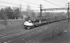 New Haven Railroad EDER-5 class EMD FL-9 locomotives # 2027 & 2000, are seen while leading westbound passenger train # 71 at Darien, Connecticut, 3-31-1966 (alcomike43) Tags: newhavenrailroad nynhh railroads trains passengertrains regionalpassengertrains commutertrains tracks rails ties rightofway roadbed ballast jointedsectionrail weldedribbonrail mainline electrifiedmainline catenary catenarysupportstructure electrification locomotives engines diesels emd eder5class electricdieselelectricroad fl9 headendcars rpo baggagecar rea heavyweightpassengercars lightweightpassengercars pullmanstandardstainlesssteelcombine train71 2027 2000 photo photograph negative bw blackandwhite old historic vintage classic