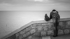 A man looks out over the Mediterranean Sea in Nice France 6/10 2018. (photoola) Tags: nice street sv france mediterranean sea photoola monochrome blackandwhite