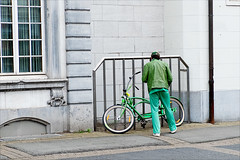 The boy in green (kceuppens) Tags: green groen stad antwerpen fiets bike bicycle straat street antwerp belgium belgie fujixt20 fuji xt20 fuji1855 1855 fun plezier city