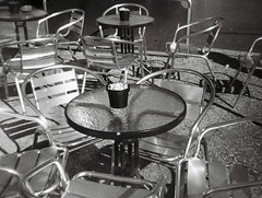 Metallic chairs (Matthew Paul Argall) Tags: ansco50 fixedfocus 110 110film subminiaturefilm lomographyfilm 100isofilm blackandwhite blackandwhitefilm chair chairs table restaurant plasticlens toycamera