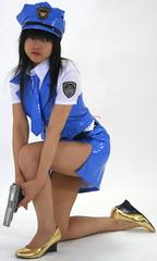 Girl Can Glock (emotiroi auranaut) Tags: girl woman police officer cop uniform cap blue leather attire clothing badge leg prepared goldshoes gun glock weapon deterrent defense
