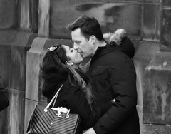 A promissory note on the bank of love (byronv2) Tags: edinburgh edimbourg oldtown blackandwhite blackwhite bw monochrome man woman embrace kiss romance hug street candid peoplewatching royalmile