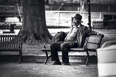 Weary Traveller (John Brighenti) Tags: oldtown alexandria va virginia town city urban daytrip spring april travel visit favorite sony alpha a7rii ilce7rm2 nex emount femount ilce bealpha sonyshooter outdoors street photography 70300mm sel70300g zoom lens telephoto people black white blackandwhite bw grey man bench park tree