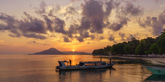 Pulau Ai. Sunset  scene while sitting on a jetty (feisas) Tags: pulauai indonesia sumatra java maluku travel tourism adventure nature beautiful landscape bagus paradise island beach sun clouds boat fishing local evening sunset volcano ocean alam water banda perfect easy asia morning sunrise colorful sonya7 fullframe amateur pantai outside outdoor southeastasia sea sky light kapal ship fishermen village kampung remote rural