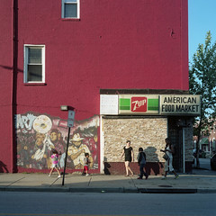 (patrickjoust) Tags: mamiya c330 s sekor 80mm f28 kodak portra 160 tlr twin lens reflex 120 6x6 medium format c41 color negative film manual focus analog mechanical patrick joust patrickjoust sowebo pigtown southwest baltimore maryland md usa us united states north america estados unidos urban street city 7up sign american food market corner store people walking man woman child children row house home red graffiti mural