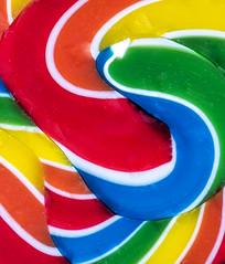 Macro Mondays Pick Two (Maureen Medina) Tags: macromondays food candy pick picktwo abstract lollipop rainbow color vibrant swirled twisted followyourarrow maureenmedina artizenimages