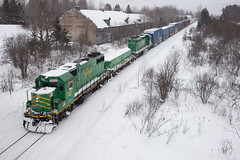 Green's Cresting the Grade - Dyer Brook, ME (CWentzell Photography) Tags: nbsr maine northern railroad railway rails freight train track snow january 2019 canon photography adobelightroom adobe emd motivepower locomotive locomotives engine engines wood landscape potato house united states america gp38 gp382 sd40 sd402 slug