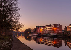 Dawn on the river. (jack cousin) Tags: england northernengland riverouse uk york yorkshire apartments apex awnings balcony barge boat boats bough branch building canalboat city dar dawn environment gable gangplank grass houseboat illumination landscape lights multistorey nature outdoors path peaceful reflection river riverbank riverboat roof serene sky tranquil tranquility tree treetrunk trees verge walkway wall water windows nikond610