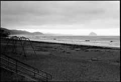 Post-Apocalyptic Beach View of Morro Rock (greenschist) Tags: california usa cayucos asahipentaxspotmaticii pacifcocean blackwhite beach supertakumer55mmf18 35mm analog film kodaktrix400