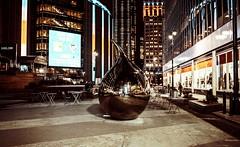 Tear drop... (cesar.toribio1218) Tags: newyork citynights teardrop art metallic nightphotography sculpture downtownny citystreets