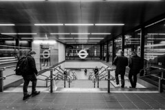 going underground twice (Paul Wrights Reserved) Tags: london londonunderground tfl leadinglines streetphotography street londonstreets blackandwhite monochrome night people reflection reflections reflectionphotography