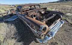 Left to Rust (magnetic_red) Tags: car rusted rust junk abandoned desert
