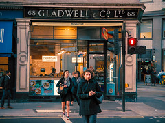 Gladwell+Co (Мaistora) Tags: street traffic light green red pedestrian commuter busy rush hurry office work city squaremile gallery art bar cafe restaurant eatery grabthai asian thai noodles clerks lunch fastfood luxury prints etchings graphics watercolour paintings dealers publishers dynasty family history tradition class culture business finance banks brokers life liestyle leica dlux typ109 lightroom lut colour grading contrast detail edit process postprocess paradox change times