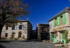 la place de ... (jean-marc losey) Tags: france occitanie tarn puycelsi place volets verts randonnée d700 automne autumn librairie