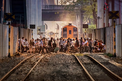 Meet the Flockers (Carl's Captures) Tags: payathaistation ratchathewidistrict bangkokthailand gradecrossing intersection traintracks railroadcrossing srt staterailwayofthailand pedestrians commuters cyclists motorists bicycles scooters traffic congestion crowded crowds people thais asian siam southeastasia urban city legs wheels rails ballast train crosssection cityscape streetshooting streetphotography throng mob mass multitude flock swarm transportation rightofway tunnel passage passageway motion movement journey routine chaos order stories smoke haze hazy walls abutments smog flocking urbanites walkers nikond7500 sigma18300 photoshopbyfehlfarben thanksbinexo