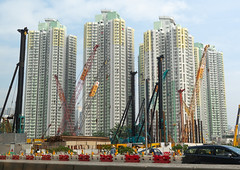 Cranes in front of residential buildings, Special Administrative Region of the People's Republic of China , Hong Kong, China (Eric Lafforgue) Tags: architecture asia blockshape buildingexterior builtstructure businessfinanceandindustry china city citylife cityscape colourimage community cranes crowdedhousing day development downtown facade finance financeandeconomy flat hongkong hongkong38 horizontal house housing housingdevelopment housingdifficulties lifestyles nopeople outdoors photography populationexplosion residentialbuilding residentialdistrict tallhigh tower town window specialadministrativeregionof specialadministrativeregionofthepeoplesrepublicofchina