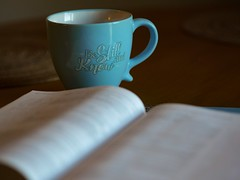 shallow focus photography of open book beside blue ceramic cup - Credit to https://myfriendscoffee.com/ (John Beans) Tags: coffee tea mug christian cafe coffeebeans shopbeans espresso coffeecup cup drink