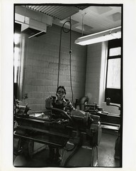Student with shop machine (Cambridge Room at the Cambridge Public Library) Tags: cambridgemass cambridge massachusetts bw blackandwhite olivepierce pierceolive cambridgerindgeandlatinschool crls