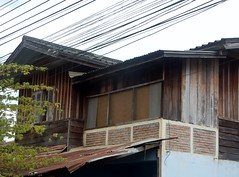 Wires Over Wood (mikecogh) Tags: luangprabang wires electrical wooden house roof corrugatediron