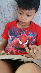 spiderman is watching Jam's homework (ghostgirl_Annver) Tags: asia asin boy brother family portrait spiderman homework teen