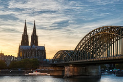 cologne (ralfkoplin) Tags: köln cologne dom brücke rhein fluss boot river rhine bridge railwaybridge cathedral church kirche ufer shore water boat wasser sunset clouds sonnenuntergang wolken deutschland germany koplin stadt city