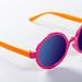Children's sunglasses in bright colors on white background