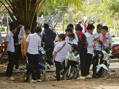 Lao School Boys (mikecogh) Tags: luangprabang schoolboys uniform group motorbikes