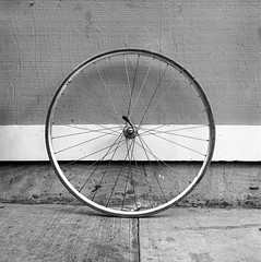 bicycle rim (queue_queue) Tags: wheel street bicycle blackandwhite rolleiflex film analog vintage sidewalk
