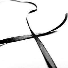 crosswise (vertblu) Tags: ribbon mono bw minimal minimalism minimalismus highkey highcontrast onwhite lookingcloseonfriday vertblu bsquare 500x500 macromode macro makro