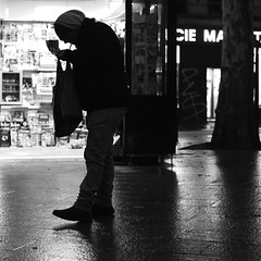 Lighting his cigarette (pascalcolin1) Tags: paris homme man nuit night pluie rain reflets reflection lumière light cigarette photoderue streetview urbanarte noiretblanc blackandwhite photopascalcolin 50mm canon50mm canon