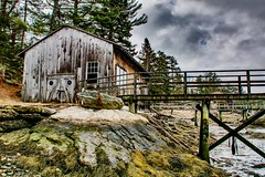 After the storm. (susanbellphotography) Tags: seaweed wood water rocks boothbayharbor maine dock coast storm rustic boathouse