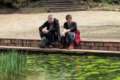 Couple Taking a Break (dckellyphoto) Tags: man woman couple spain gironaspain catalonia water green algae plants