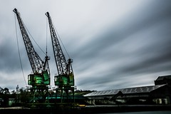 Emerald Giants... (Jess Feldon) Tags: bigstopper cranes sharpness sharpnessdocks industrial lookslikefilm jessfeldon longexposure sky clouds machinery gloucestershire emerald green