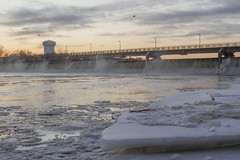 Coon Rapids Dam Regional Park (Sam Wagner Photography) Tags: brooklyn center water tower icy pancake ice winter frozen shore mississippi river coon rapids dam regional park landscape suburban midwest minnesota twin cities sunset dusk golden hour mist rushing infrastructure america usa