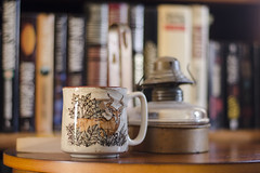 Always Dreaming (aaron_gould) Tags: bokeh coffee cup books thinking thought furniture wood nikkor color home 50mm fun blue white art old d7000