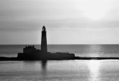 Dawn Over St. Mary's Lighthouse - B&W (Gilli8888) Tags: nikon coolpix p900 coast coastal eastcoast northeast northumberland northsea seatonsluice lighthouse stmaryslighthouse stmarysisland batesisland silhouette silhouettephotography seaside sea blackandwhite dawn morning light