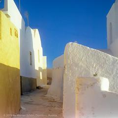 Narrow Street, Santorini, Greece (WernerSchoen) Tags: thira greece santorin griechenland 6x6 analog europe cyclades kykladen white walls blue sky yellow film ägäis