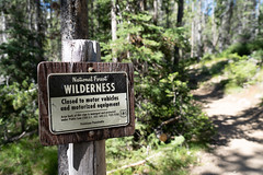 JULY 19 2018 - STANLEY, ID: Trail closed to motorized vehicles and equipment in the Sawtooth Wilderness in the Sawtooth National Recreation Area trails in Idaho on a sunny day (m01229) Tags: sunny color pine nature reflection day beauty recreation sawtoothnationalrecreationareasign trees summer tree closed scenic trail outdoors america stanley wood tranquil landscape illegal range sawtoothnationalforest daytime sawtooths reflections outdoor landscapes sawtoothmountains idaho clouds mountains warning blue adventure northamerica sunrise travel forest equipment nomotorizedvehicles american green sign sawtooth wilderness mountain