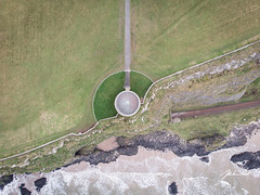 Mussenden Temple from above (jtatodd) Tags: aerial amateur architecture atlanticocean attraction beach building castlerock causewaycoast cliff coast countylondonderry dji djimavicair digital downhilldemesne dragonstone drone flight gameofthrones heritage ireland ironislands landmark landscape mussendentemple nationaltrust nature northcoast northernireland ocean photography rocks rugged scenic sea seascape sky sunset swell tide tourist waves