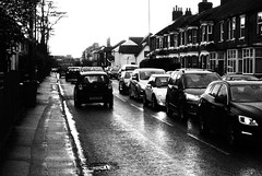 Wet Commuting (cycle.nut66) Tags: aylesbury a41 road cars traffic peak rush hour lights wet water reflection houses terrace terraced pavement tarmac olympus epl1 evolt micro fourt thirds mzuiko grainyfilmartfilter black white