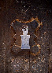 Iron Door Knocker On A Wooden Door In Sanaa, Yemen (Eric Lafforgue) Tags: arabia arabiafelix arabianpeninsula architectural architecture closeup colourpicture day historical history nopeople oldcity placeofinterest sana sanaa unescoworldheritagesite vertical yemen mg5685