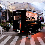 A small coffee store on wheels at a food park thumbnail