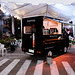 A small coffee store on wheels at a food park