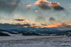 Sunset at Hospital Hill (kevin-palmer) Tags: bighornmountains bighornnationalforest wyoming buffalo february winter cold snow evening sunset gold golden color colorful orange dartonpeak peakangeline clouds hospitalhill nikond750 tamron2470mmf28