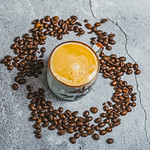 Cup of coffee surrounded by coffee beans. Top view. thumbnail