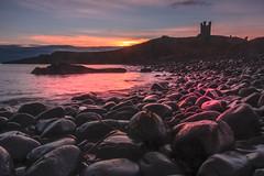 Dunstanburgh Castle Sunrise (mandyhedley) Tags: sunrise dunstanburghcastle rocks seaside coastal pink castle blackrocks northeastengland