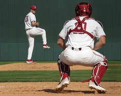 The Stanford Catcher Was Very Light On His Feet (CODA: MARINE 475) Tags: stanford cardinal college baseball red white home uniform spikes cleats cap grass field ballpark pitcher catcher portrait sports action feet levitation