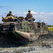 U.S. Marines drive their amphibious assault vehicle through the Nu'upia Ponds Wildlife Management Area part of the Annual 'Mud Ops