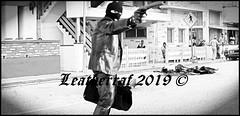 Showdown at High Noon (leatherraf) Tags: leather killer full leatherjeans pants mask balaclava glove jacket blazer silencer gun hitman robber heister kidnapper sicario black boots sex fetish assassin blood mayhem slaughter murder masked