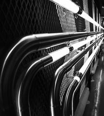 Guinness pipeline, Dublin (Hammerhead27) Tags: metal bw ireland dublin monochrome blackandwhite dark tubes lines tourist lights pipe guinnessstore